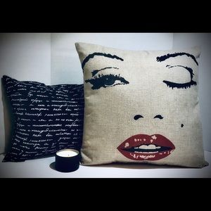 Pillows two.  Marilyn Monroe and French words.